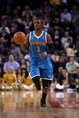 OAKLAND, CA - FEBRUARY 15:  Chris Paul #3 of the New Orleans Hornets in action against the Golden State Warriors at Oracle Arena on February 15, 2011 in Oakland, California. NOTE TO USER: User expressly acknowledges and agrees that, by downloading and or