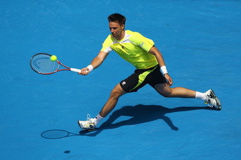 MELBOURNE, AUSTRALIA - JANUARY 24:  Robin Soderling of Sweden plays forehand in his fourth round match against Alexandr Dolgopolov of the Ukraine during day eight of the 2011 Australian Open at Melbourne Park on January 24, 2011 in Melbourne, Australia.
