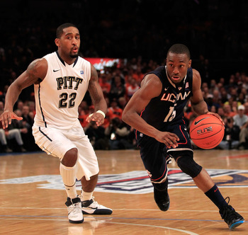 NEW YORK, NY - MARCH 10: Kemba Walker #15 of the Connecticut Huskies drives toward the hoop against Brad Wanamaker #22 of the Pittsburgh Panthers during the quarterfinals of the 2011 Big East Men's Basketball Tournament presented by American Eagle Outfitt