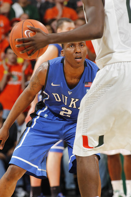 CORAL GABLES, FL - FEBRUARY 13: Nolan Smith #2 of the Duke Blue Devils defends against Durand Scott #1 of the Miami Hurricanes on February 13, 2011 at the BankUnited Center in Coral Gables, Florida. (Photo by Joel Auerbach/Getty Images)