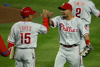 LOS ANGELES, CA - OCTOBER 13:  (R) Shane Victorino #8 of the Philadelphia Phillies celebrates with coach Davey Lopes #15 after defeating the Los Angeles Dodgers 7-5 in Game Four of the National League Championship Series during the 2008 MLB playoffs on Oc
