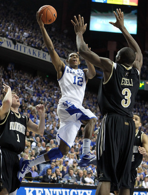 LEXINGTON, KY - MARCH 01:  Brandon Knight #12 of the Kentucky Wildcats shoots the ball while defended by Festus Ezeli #3 of the Vanderbilt Commodores  during the Kentucky 68-66 win in the SEC game at Rupp Arena on March 1, 2011 in Lexington, Kentucky.  (P