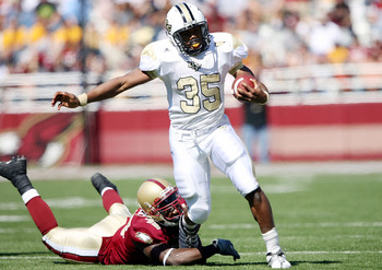 CHESTNUT HILL, MA - SEPTEMBER 20:  Ronnie Weaver #35 of the Central Florida Knights carries the ball as Wes Davis #45 of the Boston College Eagles tries to tackle on September 20, 2008 at Alumni Stadium in Chestnut Hill, Massachusetts.  (Photo by Elsa/Get