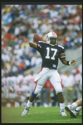 1990:  Quarterback Reggie Slack of the Auburn Tigers passes the ball during a game against the Ohio State Buckeyes in Florida.  Auburn won the game 31-14. Mandatory Credit: Scott Halleran  /Allsport