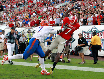 JACKSONVILLE, FL - OCTOBER 30:  Orson Charle #7 of the Georgia Bulldogs attempts to catch a pass against Ronald Powell #7 of the Florida Gators during the game at EverBank Field on October 30, 2010 in Jacksonville, Florida.  (Photo by Sam Greenwood/Getty