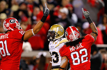 ATLANTA - NOVEMBER 28:  Aron White #81 and Michael Moore #82 of the Georgia Bulldogs celebrate Moore's touchdown against the Georgia Tech Yellow Jackets at Bobby Dodd Stadium on November 28, 2009 in Atlanta, Georgia.  (Photo by Kevin C. Cox/Getty Images)