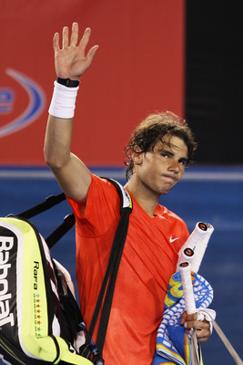 MELBOURNE, AUSTRALIA - JANUARY 26:  Rafael Nadal of Spain waves after losing in his quarterfinal match against David Ferrer of Spain during day ten of the 2011 Australian Open at Melbourne Park on January 26, 2011 in Melbourne, Australia.  (Photo by Clive