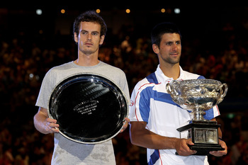 MELBOURNE, AUSTRALIA - JANUARY 30:  Novak Djokovic of Serbia (R) poses with the Norman Brookes Challenge Cup after winning his men's final match against Andy Murray of Great Britain (L) during day fourteen of the 2011 Australian Open at Melbourne Park on