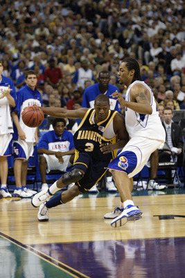 NEW ORLEANS - APRIL 5:  Dwyane Wade #3 of Marquette University Golden Eagles drives around Jeff Graves #42 of the University of Kansas Jayhawks during the semifinal round of the NCAA Final Four Tournament at the Louisiana Superdome on April 5, 2003 in New