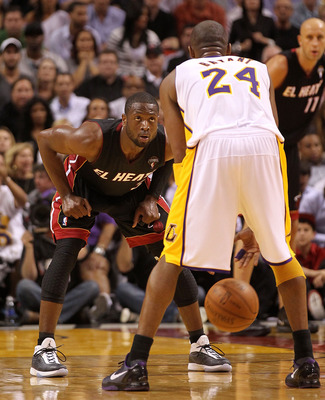 MIAMI, FL - MARCH 10:  Dwyane Wade #3 of the Miami Heat defends Kobe Bryant #24 of the Los Angeles Lakers during a game at American Airlines Arena on March 10, 2011 in Miami, Florida. NOTE TO USER: User expressly acknowledges and agrees that, by downloadi