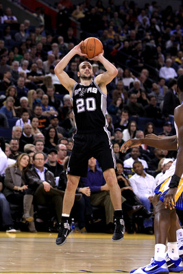 OAKLAND, CA - JANUARY 24:  Manu Ginobili #20 of the San Antonio Spurs in action against the Golden State Warriors at Oracle Arena on January 24, 2011 in Oakland, California.  NOTE TO USER: User expressly acknowledges and agrees that, by downloading and or