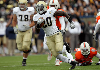 EL PASO, TX - DECEMBER 30:  Running back Cierre Wood #20 of the Notre Dame Fighting Irish runs for a touchdown against the Miami Hurricanes during the Hyundai Sun Bowl at Sun Bowl on December 30, 2010 in El Paso, Texas.  (Photo by Ronald Martinez/Getty Im