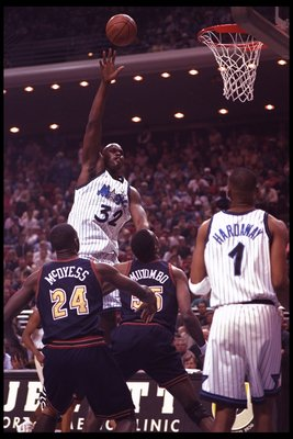 13 Feb 1996: Guard Anfernee 'Penny' Hardaway of the Orlando Magic watches teammate center Shaquille O'Neal shoot for the basket against Denver Nuggets forward Antonio McDyess and Dikembe Mutombo during a game played at the Orlando Arena in Orlando, Florid