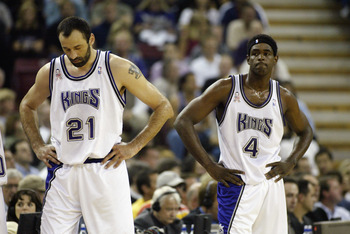 SACRAMENTO, CA - MAY 20:  Vlade Divac #21 and Chris Webber #4 of the Sacramento Kings during Game two of the Western Conference Finals against the Los Angeles Lakers during the 2002 NBA Playoffs at Arco Arena in Sacramento, California on May 20, 2002.  Th