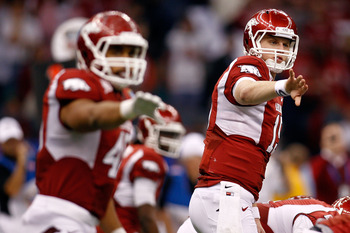 NEW ORLEANS, LA - JANUARY 04:  (R) Ryan Mallett #15 of the Arkansas Razorbacks calls out alongside Jarius Wright #4 against the Ohio State Buckeyes during the Allstate Sugar Bowl at the Louisiana Superdome on January 4, 2011 in New Orleans, Louisiana.  (P