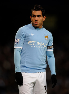 MANCHESTER, ENGLAND - MARCH 05:  Carlos Tevez  of Manchester City looks on during the Barclays Premier League match between Manchester City and Wigan Athletic at the City of Manchester Stadium on March 5, 2011 in Manchester, England.  (Photo by Laurence G