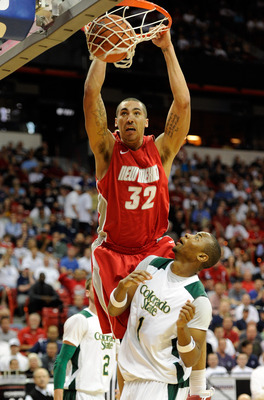LAS VEGAS, NV - MARCH 10:  Drew Gordon #32 of the New Mexico Lobos dunks over Travis Franklin #1 of the Colorado State Rams during a quarterfinal game of the Conoco Mountain West Conference Basketball tournament at the Thomas & Mack Center March 10, 2011