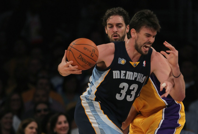 LOS ANGELES, CA - NOVEMBER 02:  Marc Gasol #33 of the Memphis Grizzlies drives past Pau Gasol #16 of the Los Angeles Lakers to the basket during the first quarter at Staples Center on November 2, 2010 in Los Angeles, California. NOTE TO USER: User express