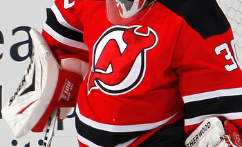 NEWARK, NJ - MARCH 02:  Goalie Martin Brodeur #30 of the New Jersey Devils makes a save during an NHL hockey game against the Tampa Bay Lightning at the Prudential Center on March 2, 2011 in Newark, New Jersey.  (Photo by Paul Bereswill/Getty Images)