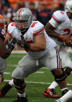 CHAMPAIGN, IL - OCTOBER 02: Justin Boren #65 of the Ohio State Buckeyes blocks against the Illinois Fighting Illini at Memorial Stadium on October 2, 2010 in Champaign, Illinois. Ohio State defeated Illinois 24-13. (Photo by Jonathan Daniel/Getty Images)