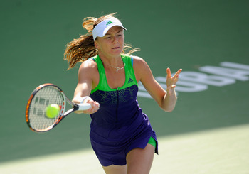 DUBAI, UNITED ARAB EMIRATES - FEBRUARY 15:  Daniela Hantuchova of Slovakia plays a shot during her Round 1 defeat to Anna Chakvetadze of Russia during day two of the WTA Dubai Duty Free Tennis Championships at the Dubai Tennis Stadium on February 15, 2011