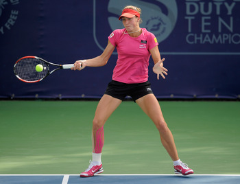 DUBAI, UNITED ARAB EMIRATES - FEBRUARY 17:  Yanina Wickmayer of Belgium plays a shot in her Round 3 match against Shahar Peer of Israel during day four of the WTA Dubai Duty Free Tennis Championships at the Dubai Tennis Stadium on February 17, 2011 in Dub
