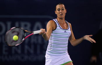 DUBAI, UNITED ARAB EMIRATES - FEBRUARY 19:  Flavia Pennetta of Italy plays a shot during her semi-final against Svetlana Kuznetsova of Russia during day six of the Dubai Duty Free Tennis Championships at the Dubai Tennis Stadium on February 19, 2011 in Du