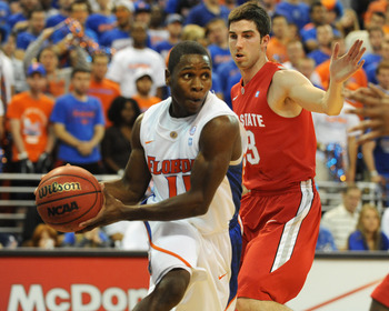 GAINESVILLE, FL - NOVEMBER 16: Guard Erving Walker #11 of the Florida Gators looks to pass against the Ohio State Buckeyes November 16, 2010 at the Stephen C. O'Connell Center in Gainesville, Florida.  (Photo by Al Messerschmidt/Getty Images)