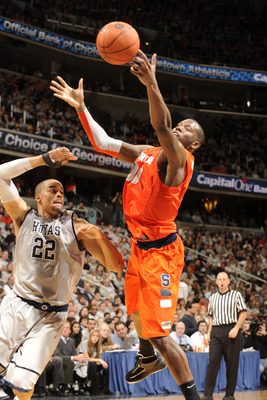 WASHINGTON, DC - FEBRUARY 26:  Rick Jackson #00 of the Syracuse Orange goes after a loose ball against Julian Vaughn #22 of the Georgetown Hoyas on February 26, 2011 at the Verizon Center in Washington, DC  The Orange 58-51.  (Photo by Mitchell Layton/Get