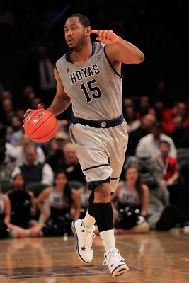 NEW YORK, NY - MARCH 09:  Austin Freeman #15 of the Georgetown Hoyas dribbles the ball against the Connecticut Huskies during the second round of the 2011 Big East Men's Basketball Tournament presented by American Eagle Outfitters at Madison Square Garden