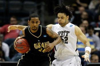 MILWAUKEE - MARCH 19:  Keith Benson #34 of the Oakland Golden Grizzlies posts up Gary McGhee #52 of the Pittsburgh Panthers in the second half during the first round of the 2010 NCAA men's basketball tournament at the Bradley Center on March 19, 2010 in M