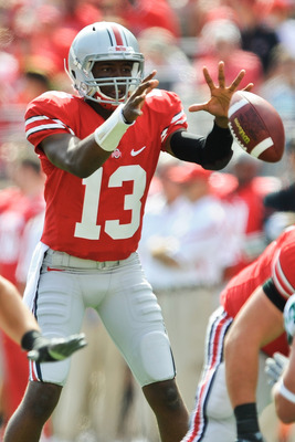 COLUMBUS, OH - SEPTEMBER 18:  Quarterback Ken Guiton #13 of the Ohio State Buckeyes takes the snap against the Ohio Bobcats at Ohio Stadium on September 18, 2010 in Columbus, Ohio.  (Photo by Jamie Sabau/Getty Images)