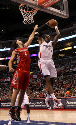 LOS ANGELES, CA - DECEMBER 22:   Rasual Butler #45 of the Los Angeles Clippers grabs a rebound against Luis Scola #4 of the Houston Rockets at Staples Center on December 22, 2010 in Los Angeles, California.  The Rockets won 97-92. NOTE TO USER: User expre