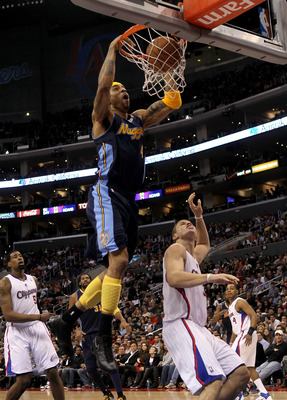 LOS ANGELES, CA - MARCH 5:  Kenyon Martin #4 of the Denver Nuggets dunks over Blake Griffin #32 of the Los Angeles Clippers at Staples Center on March 5, 2011 in Los Angeles, California. The Clippers won 100-94. NOTE TO USER: User expressly acknowledges a