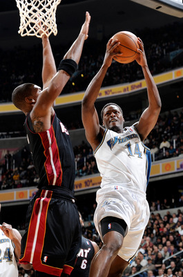 WASHINGTON, DC - DECEMBER 18:  Al Thornton #14 of the Washington Wizards drives to the hoop against Chris Bosh #1 of the Miami Heat at the Verizon Center on December 18, 2010 in Washington, DC. NOTE TO USER: User expressly acknowledges and agrees that, by