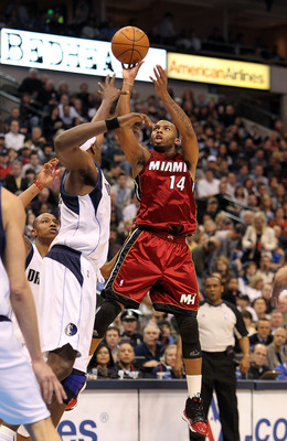 DALLAS - FEBRUARY 20:  Guard Daequan Cook #14 of the Miami Heat takes a shot against Brendan Haywood #33 of the Dallas Mavericks on February 20, 2010 at American Airlines Center in Dallas, Texas.  NOTE TO USER: User expressly acknowledges and agrees that,