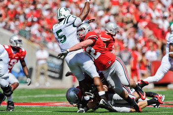 COLUMBUS, OH - SEPTEMBER 18:  Storm Klein #32 of the Ohio State Buckeyes hits quarterback Phil Bates #5 of the Ohio Bobcats right after Bates releases the ball at Ohio Stadium on September 18, 2010 in Columbus, Ohio.  (Photo by Jamie Sabau/Getty Images)