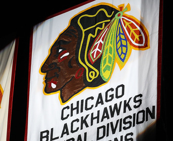 CHICAGO - OCTOBER 09: A Championship banner is seen during a ceremony before the Chicago Blackhawks season home opening game against the Detroit Red Wings at the United Center on October 9, 2010 in Chicago, Illinois. (Photo by Jonathan Daniel/Getty Images