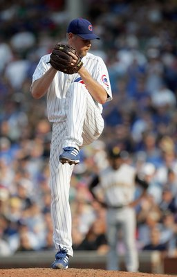 CHICAGO - SEPTEMBER 21: Kerry Wood #34 of the Chicago Cubs delivers the pitch during the game against the Pittsburgh Pirates on September 21, 2007 at Wrigley Field in Chicago, Illinois. The Cubs defeated the Pirates 13-7. (Photo by Jonathan Daniel/Getty I