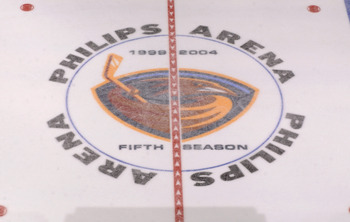 ATLANTA - MARCH 5:  The Atlanta Thrashers logo at center ice commemorating the fifth season in the NHL before the game between the Carolina Hurricanes and the Atlanta Thrashers on March 5, 2004 at Philips Arena in Atlanta, Georgia.  The Hurricanes defeate