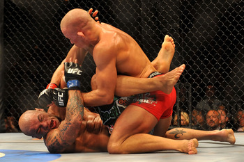 LAS VEGAS - JULY 11:  (Top) Georges St. Pierre battles Thiago Alves during their welterweight title bout during UFC 100 on July 11, 2009 in Las Vegas, Nevada.  (Photo by Jon Kopaloff/Getty Images)