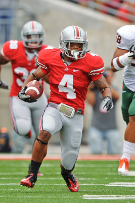 COLUMBUS, OH - SEPTEMBER 11:  Jaamal Berry #4 of the Ohio State Buckeyes runs with the ball against the Miami Hurricanes at Ohio Stadium on September 11, 2010 in Columbus, Ohio.  (Photo by Jamie Sabau/Getty Images)