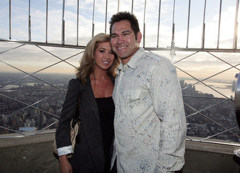 NEW YORK - NOVEMBER 24:  New York Yankee Johnny Damon and his wife Michelle poses for a photo at the top of the Empire State Building on November 24, 2009 in New York City. Johnny Damon was a guest speaker to proclaim today as Jimmie Johnson Day in NYC. (