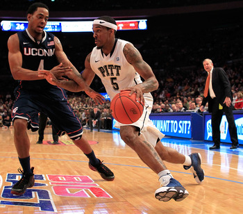 NEW YORK, NY - MARCH 10: Gilbert Brown #5 of the Pittsburgh Panthers dribbles past Jamal Coombs-McDaniel #4 of the Connecticut Huskies during the quarterfinals of the 2011 Big East Men's Basketball Tournament presented by American Eagle Outfitters  at Mad