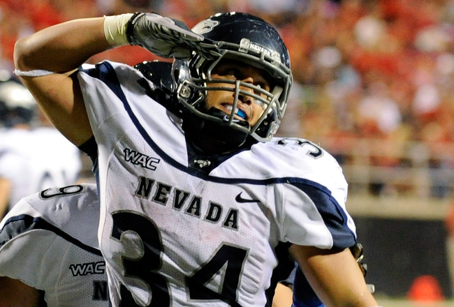 LAS VEGAS - OCTOBER 02:  Vai Taua #34 of the Nevada Reno Wolf Pack celebrates after scoring a touchdown against the UNLV Rebels in the second quarter of their game at Sam Boyd Stadium October 2, 2010 in Las Vegas, Nevada. Nevada Reno won 44-26.  (Photo by