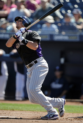 PEORIA, AZ - MARCH 02:  Troy Tulowitzki #2 of the Colorado Rockies at bat against the San Diego Padres during spring training at Peoria Stadium on March 2, 2011 in Peoria, Arizona.  (Photo by Harry How/Getty Images)
