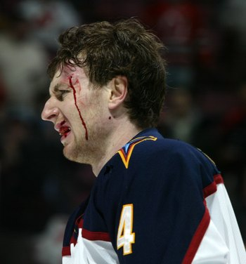 EAST RUTHERFORD, NJ - JANUARY 12: Braydon Coburn #4 of the Atlanta Thrashers goes off the ice bloodied after his fight with Mike Rupp (not pictured) of the New Jersey Devils at the Continental Airlines Arena on January 12, 2007 in East Rutherford, New Jer