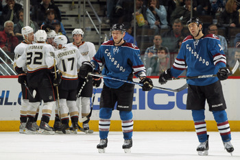 DENVER, CO - MARCH 11:  Ryan Getzlaf #15, Toni Lydman #32 and Lubomir Visnovsky #17 celebrate a third period goal by teammate Bobby Ryan #9 of t he Anaheim Ducks as Kevin Porter #12 and David Winnik #34 of the Colorado Avalanche skate off the ice during N