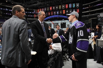 LOS ANGELES, CA - JUNE 26:  Tyler Toffoli shakes hands with team personnel after being drafted in the second round by the Los Angeles Kings during day two of the 2010 NHL Entry Draft at Staples Center on June 26, 2010 in Los Angeles, California.  (Photo b