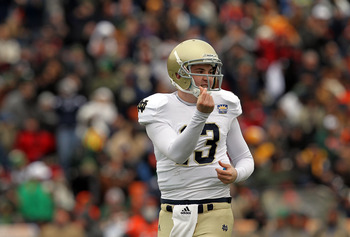 EL PASO, TX - DECEMBER 30:  Quarterback Tommy Rees #13 of the Notre Dame Fighting Irish celebrates a touchdown against the Miami Hurricanes at Sun Bowl on December 30, 2010 in El Paso, Texas.  (Photo by Ronald Martinez/Getty Images)